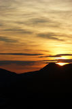 Golden sunset in the mountains Stock Images