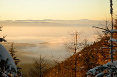 Golden sunset in the mountains, a vast fog over the valley. Golden sunset in the mountains, a vast fog over the valley Royalty Free Stock Photos