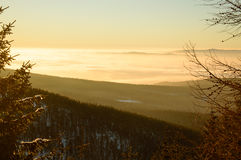 Golden sunset in the mountains, a vast fog over the valley. Golden sunset in the mountains, a vast fog over the valley Stock Photo