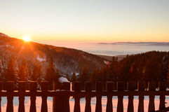 Golden sunset in the mountains, a vast fog over the valley. Golden sunset in the mountains, a vast fog over the valley Stock Photos