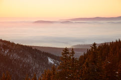 Golden sunset in the mountains, a vast fog over the valley. Golden sunset in the mountains, a vast fog over the valley Royalty Free Stock Images