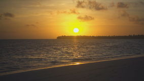 Golden sunset and ocean waves on the island stock video footage