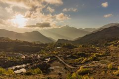 A golden sunset over ancient village. stock photography