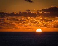 Golden sunset over the Atlantic ocean Stock Images