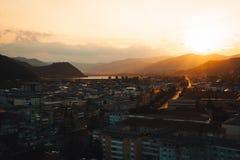 Golden sunset over city Stock Photo