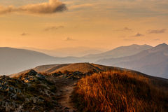 Golden sunset over european mountains royalty free stock images