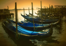 A golden sunset over gondolas stock photo