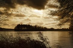 Nature scene of golden sunset over lake. Golden sunset reflecting in a water of a lake. Siek county in north Germany royalty free stock photos