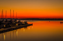 Golden Sunset over Marina Stock Images