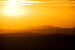 Golden Sunset over Mountains Stock Photography