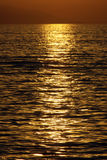 Golden sunset over ocean Royalty Free Stock Photos