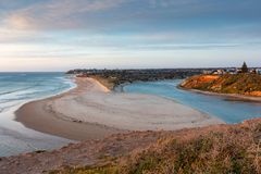A golden Sunset over the Onkaparinga River mouth looking north t. Owards the Port Noarlunga Jetty in South Australia on 23rd September 2018 royalty free stock images