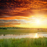Golden sunset over river Royalty Free Stock Photo