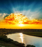 Golden sunset over river Stock Images