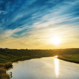 Golden sunset over river with reflections Royalty Free Stock Photo