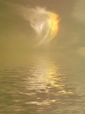 Golden sunset over sea. Scenic view of golden sunset behind cloudscape reflecting on calm sea Royalty Free Stock Photo