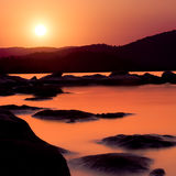Golden sunset over shallow water Royalty Free Stock Photo