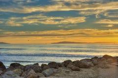 Golden sunset over shiny ocean water. Stock Image