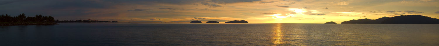 Golden Sunset Panorama. A ultra wide panorama view of a golden sunset ocean Royalty Free Stock Photo