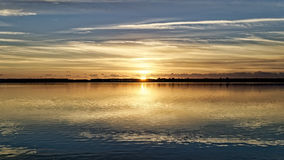 Golden sunset picture. Golden sunset on the patria lake in the province of Naples. clouds are reflected perfectly on the surface of the lake Royalty Free Stock Photos