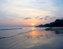 Golden Sunset with Reflection in Sea Water at Radhanagar Beach, Havelock Island, Andaman, India. This is a photograph of golden sunset over ocean... The image is stock photography