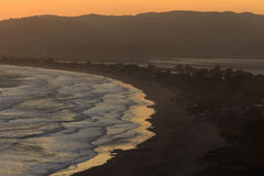 Golden sunset reflects on water's edge at Stinson Beach Stock Photos