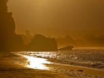 Golden sunset rocky coast. An orange glow sunset over a rocky coast Royalty Free Stock Photography