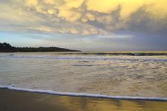 Golden sunset in the sea. Golden sunset on the sea beach of Santander Spain Royalty Free Stock Photo