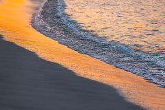 Golden sunset on the sea shore Stock Image