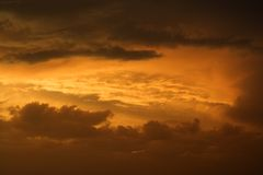 Golden sunset sky and clouds. Royalty Free Stock Photo