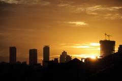 Golden sunset sky in Jakarta. Golden light of sunset sky over cityscape in Jakarta, Indonesia Royalty Free Stock Photography