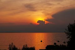 Golden sunset sky and waters at lake Garda Royalty Free Stock Photography