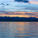 Golden Sunset - Square. Golden sunset reflecting on a spring mountain lake Stock Photo