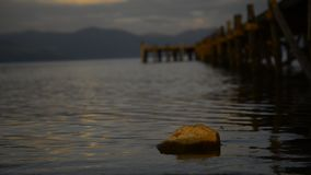 Golden sunset stone on  a Great  Prespa Lake stock footage
