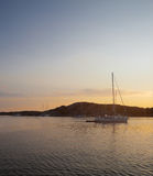 Golden sunset in swedish cove. Summertime on swedish coast. Scenic view of a small cove with sail boats and motor boats Stock Image