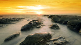 Golden sunset at tip of borneo Royalty Free Stock Images
