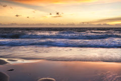 Golden sunset on tropical beach Stock Photo