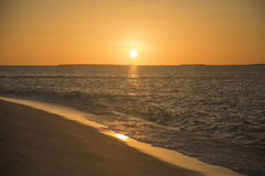 Golden sunset on a tropical island. Stock Image