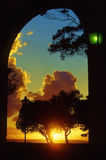Golden sunset under a porch, and green street-lamp royalty free stock photos