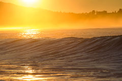 Golden surf. Another day starting as perfectly as the last, life is good. Golden sunlight hitting quality surf waves Stock Photo