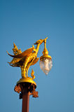 Golden swan lamp. On the blue sky Stock Photo