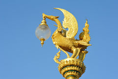 Golden Swan lamp on electricity Stock Image