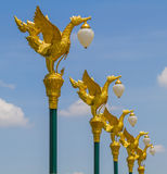 Golden swan lamp facing right on Royalty Free Stock Photos
