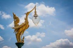 Golden swan lamp post Stock Photos