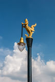 Golden swan lamp and wind bell in temple Stock Photo