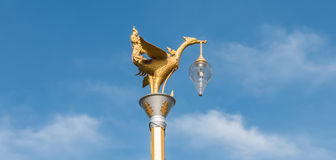 Golden swan lamp and wind bell in temple Royalty Free Stock Photo