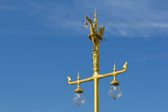 Golden swan post lamp. On blue sky background Royalty Free Stock Image