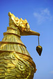 Golden swan statue and blue sky Stock Photography