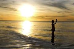 Golden swash traveler. Sunrise golden swash traveler at Nava Gorn beach, Prachuap Khiri Khan country Thailand Stock Image