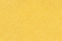 Golden sweater knitted  fabric texture for background. Stock Images
